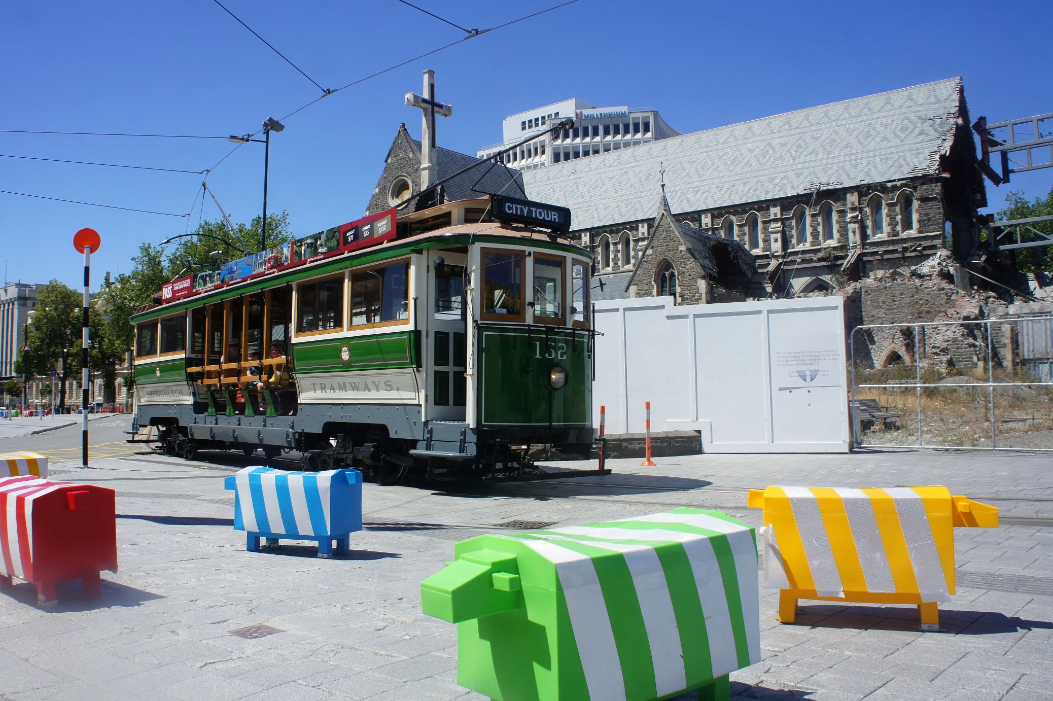 Compulsory picture of sheep in New Zealand. These traffic sheep are accompanied by the tourist tram and the severely damaged Christchurch Cathedral.
