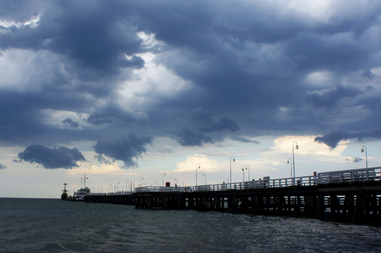 IT'S NOT ALL BLUE SKIES AS A REMOTE WORKER. A STORM ROLLS IN AT THE POLISH SEASIDE RESORT OF SOPOT