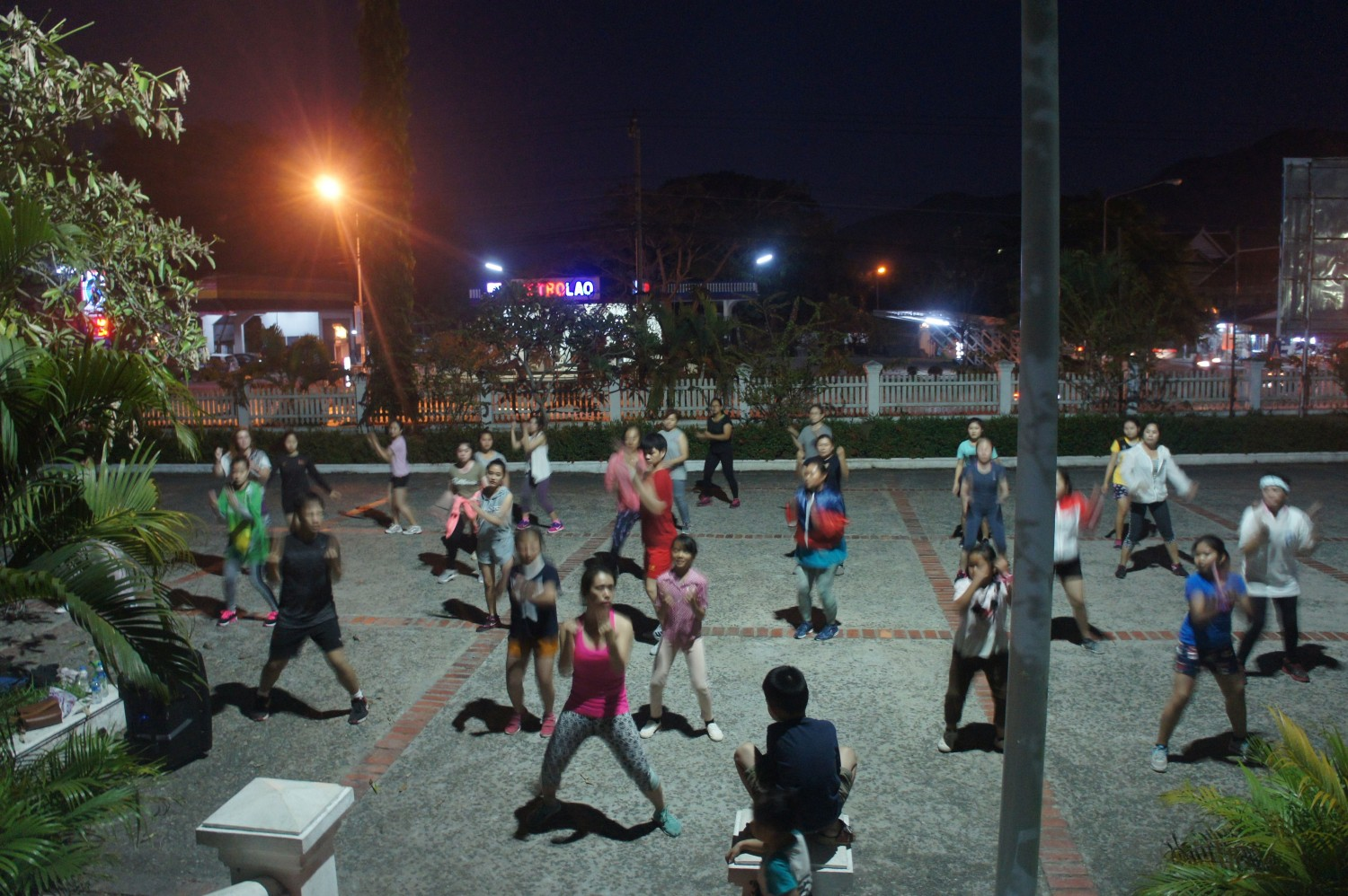 Zumba just around the corner from the Kaysone Phomvihane Monument, Luang Prabang