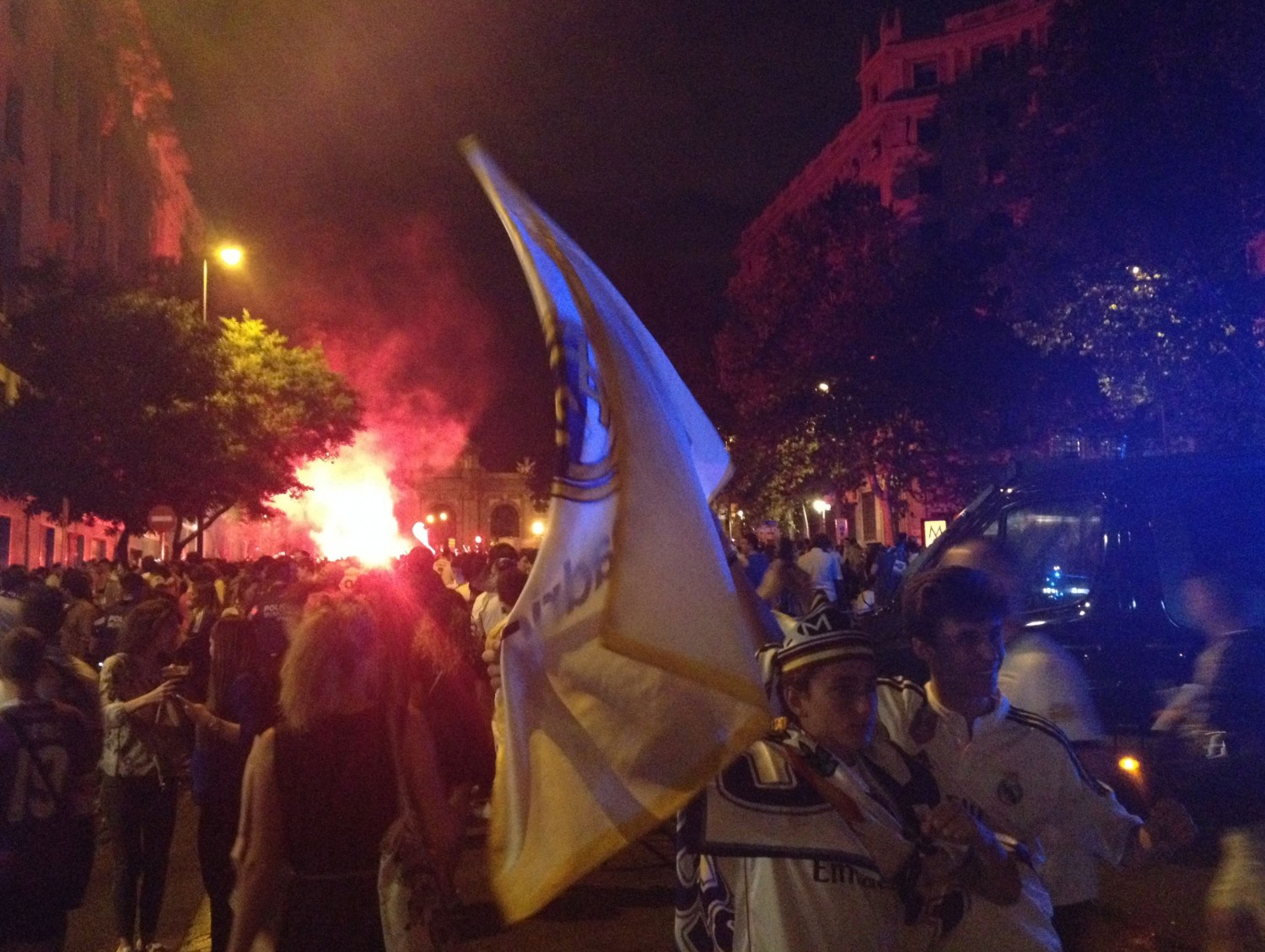 Celebrating in the streets with new friends after Real Madrid wins the Champions League final